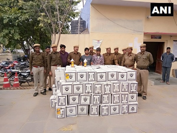 Police officials along with the seized goods and accused. Photo/ANI