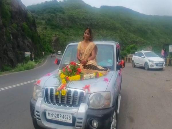 The woman sitting on a car bonnet. (Photo/ANI)