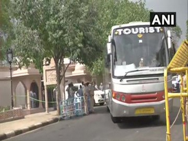 Buses, carrying MLAs, leave from the residence of Chief Minister Ashok Gehlot after the Congress Legislative Party (CLP) meeting concluded on Monday.