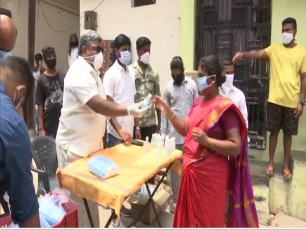 TPCC distributes face masks and sanitizers to poor in Adda Gutta slum of Hyderabad city on Sunday [Photo/ANI]