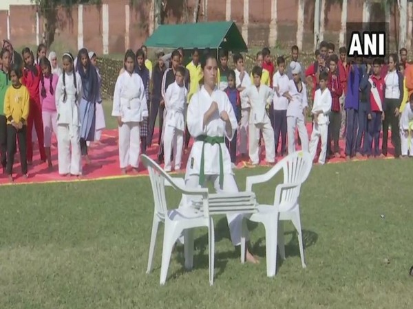 A girl performing a martial art stunt at the camp in Rajouri district of Jammu and Kashmir on Sunday. Photo/ANI