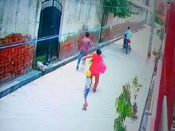 A CCTV footage where a woman is seen running behind the assailants who snatched her chain