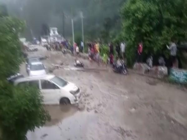 Visual of cars stuck in debris (Photo/ANI)