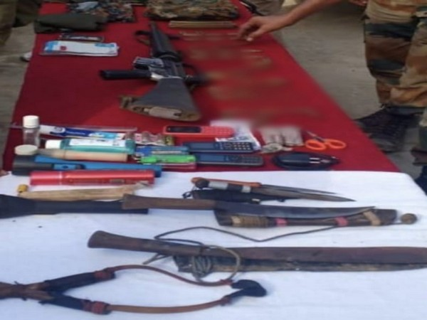 A large quantity of war-like stores was recovered from slain insurgent including an assault rifle. Photo/ANI