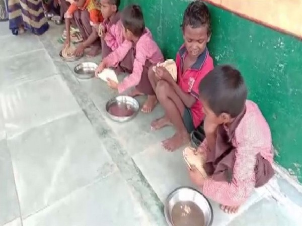 Children forced to have chappatis with salt at primary school in Mirzapur on August 22 . Photo/ANI