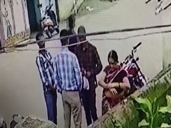 Three men were seen assisting the woman to take off her ornaments in Kalahandi, Odisha, on Friday. Photo/ANI