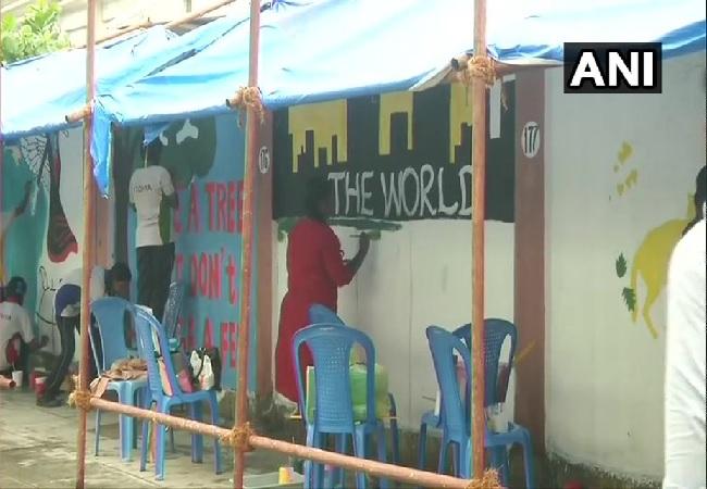 Mega Wall painting activity on the outside walls at Chennai Airport on Saturday.