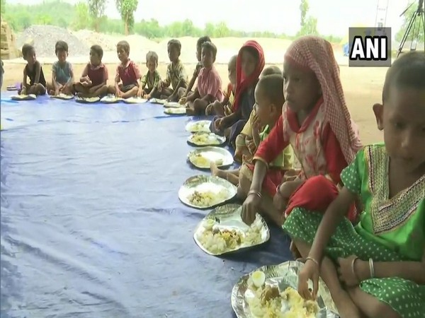 Tribal kids enjoying their lunch in Dantewada, Chhattisgarh on Monday. Photo/ANI