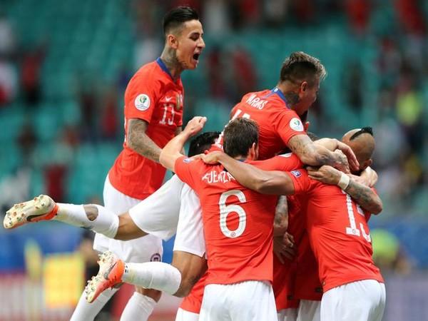 Chile players celebrating after scoring goal against Equador