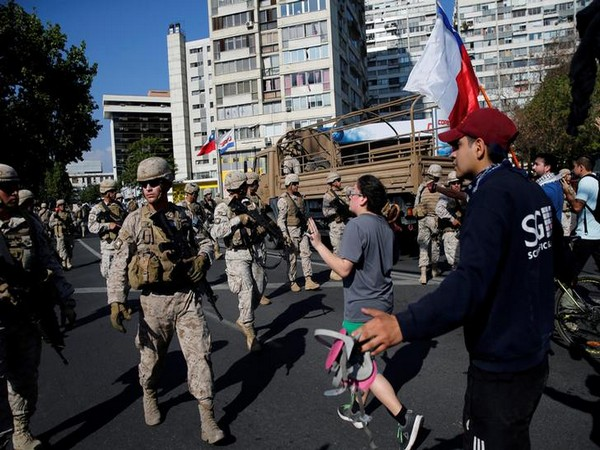 Violence continues as Chile extends curfew for second night after new clashes