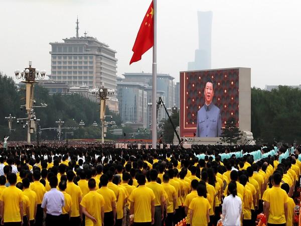 A giant screen shows Chinese President Xi Jinping in Beijing.