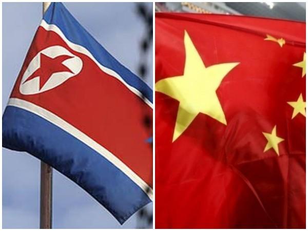 China and North Korea flags
