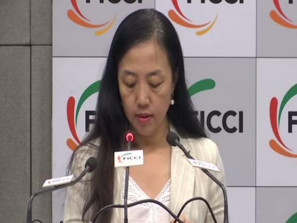 Zhu Xiaohong, Counselor, Embassy of China, speaking at the India-China Business Meeting & Signing Ceremony in New Delhi on Thursday.