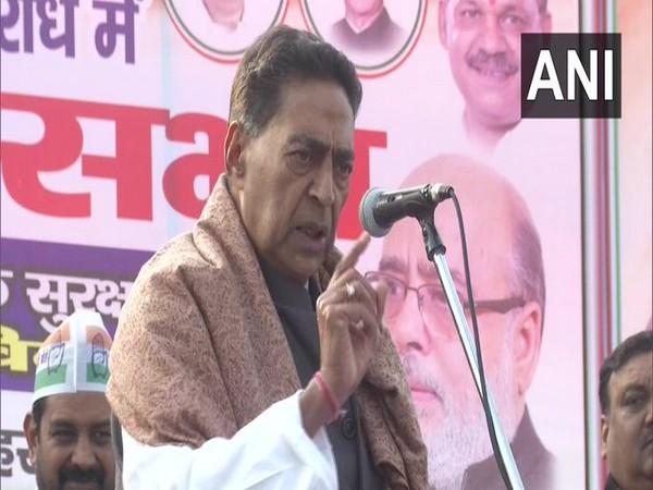 Subhash Chopra addressing a rally in New Delhi on Wednesday. Photo/ANI