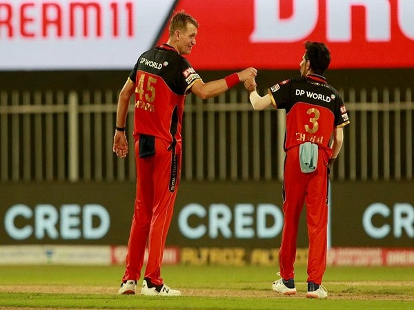 RCB bowlers Chris Morris and Yuzvendra Chahal (Image: BCCI/IPL)