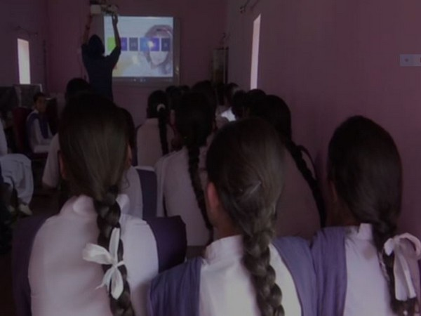 Students studying with the help of smart-board at Government Girls Higher Secondary School, Kalsian, Nowshera
