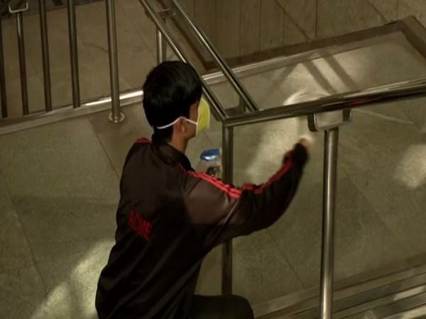 A worker sanitising Rajiv Chowk metro station staircases in New Delhi on Friday. Photo/ANI