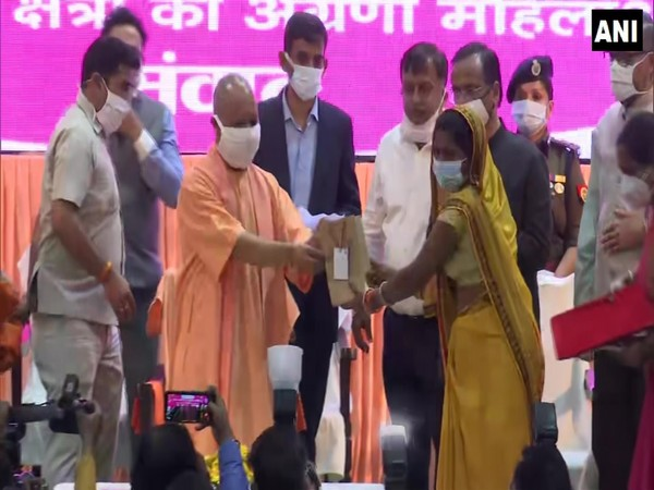 CM Yogi giving the Mission Shakti Awards to woman on the occasion of International Women's Day (Photo/ANI)
