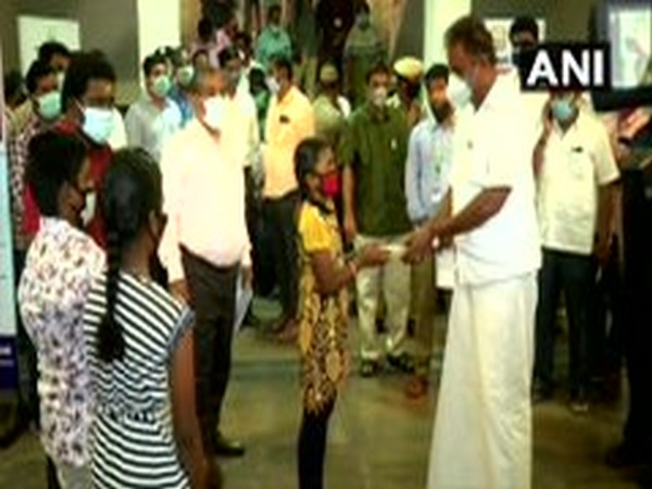 The student and her siblings handed over their contribution to Municipal Administration Minister SP Velumani. (Photo/ANI)
