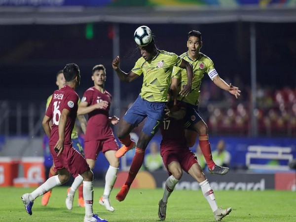 Players in action in the match between Colombia and Qatar