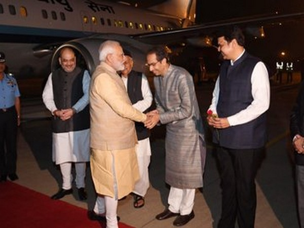 Maharashtra Chief Minister Uddhav Thackeray welcoming Prime Minister Narendra Modi at Pune airport on Friday. Home Minister Amit Shah is also seen. Photo/ANI