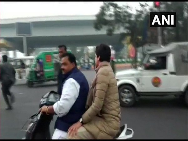 Congress leader Dheeraj Gurjar with Priyanka Gandhi Vadra on scooter on Saturday in Lucknow. Photo/ANI