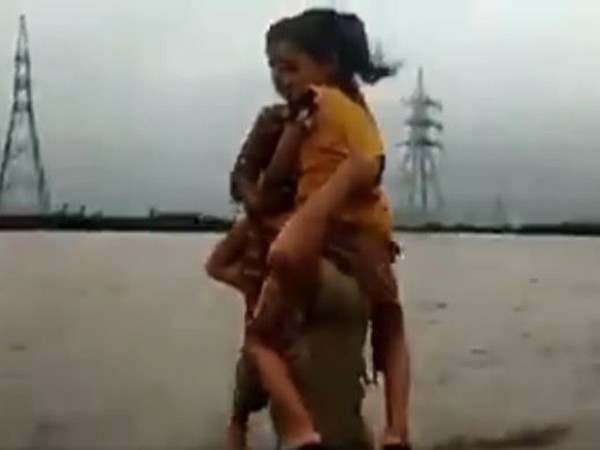 A constable was seen carrying children on his shoulders in floodwaters in Morbi district of Gujarat.