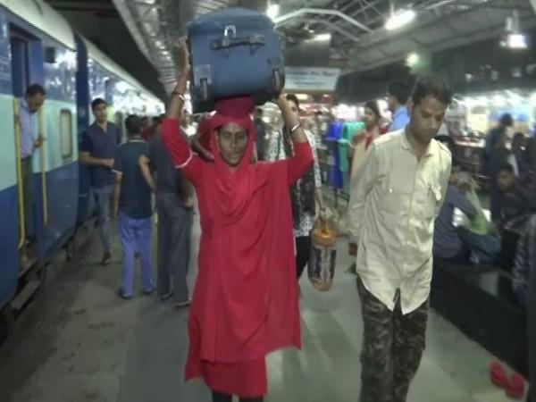 Lakshmi working at Bhopal Junction Raiway station. Photo/ANI