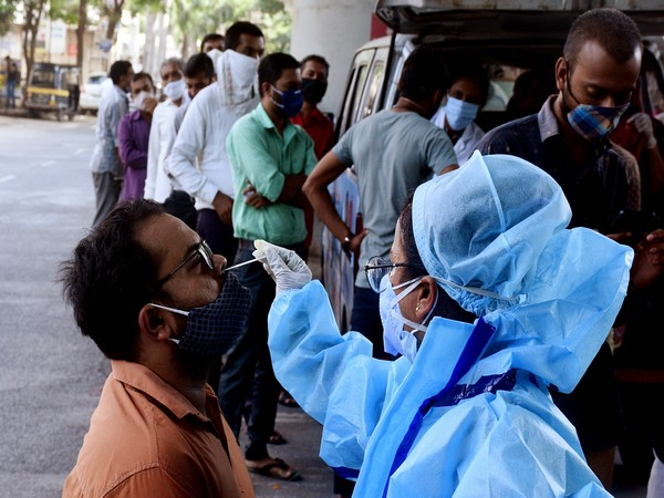 A health workers take nasal swab samples for COVID-19 test. (Photo/ANI)