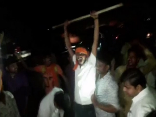 Vishwa Hindu Parishad and Bajrang Dal workers raising slogans outside the government school in Gwalior on Wednesday. Photo/ANI