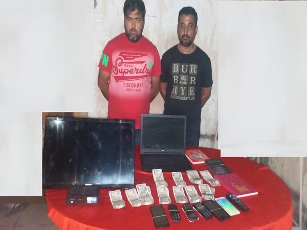 Arrested bookies along with confiscated material