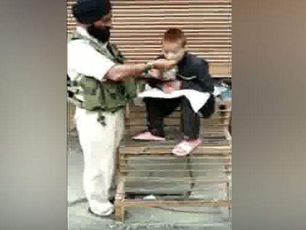 A video grab of the CRPF driver feeding a specially-abled Kashmiri boy. Photo/ANI