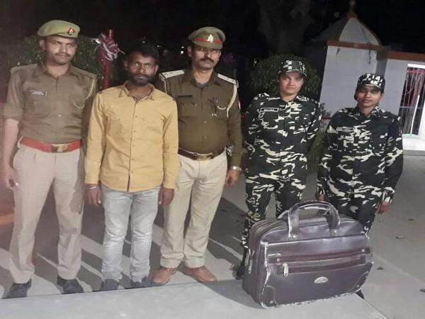 Sashastra Seema Bal (SSB) officerswith detained person in Rupaidiha area of Bahraich in Uttar Pradesh on Saturday. (Photo/ANI)