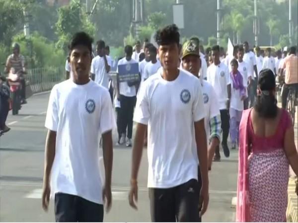 Mini marathon organised in Odisha to create awareness about Cyclone. [Photo/ANI]