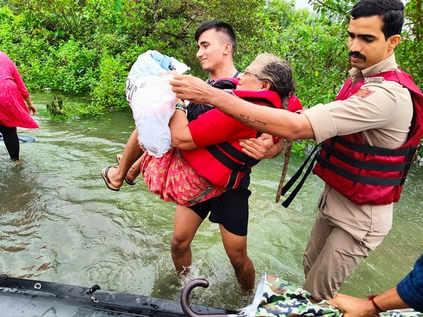 Indian Navy teams evacuating people from flood affected areas