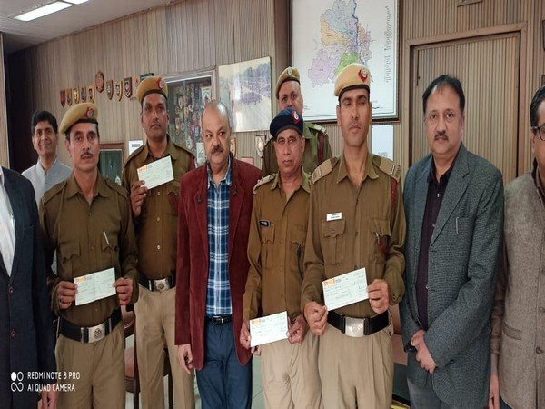 Delhi Fire Services personnel were awarded Rs 2 lakh each on Wednesday. Photo/ANI