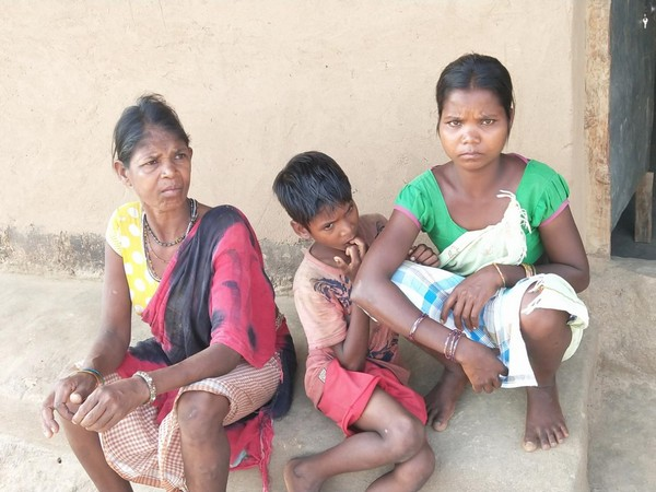 Dhule (L) sitting with her son and a wife outside her house in Pakhnachua village [Photo/ANI]