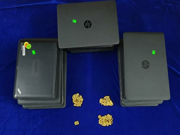 Gold and laptops recovered by the Customs department. Photo/ANI