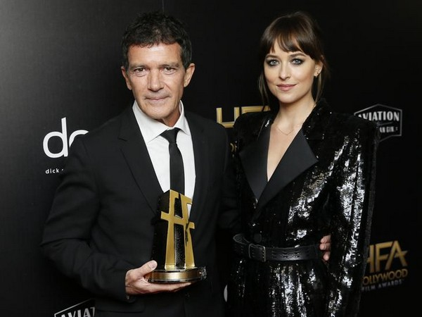 Dakota Johnson poses with Antonio Banderas