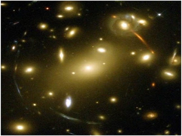 Gravity of clumps of dark matter can distort light from distant objects (Picture Courtesy: JPL-NASA)