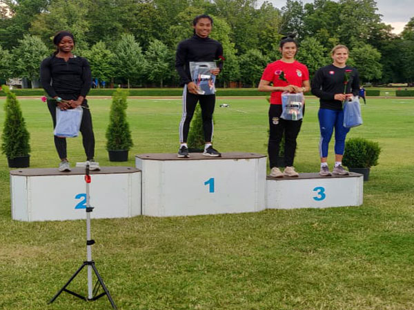 Indian sprinter Hima Das at the podium with the gold. (Photo/ Hima Das Twitter)