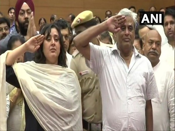 Sushma Swaraj's daughter and husband saluting her mortal remains at BJP headquarters in New Delhi