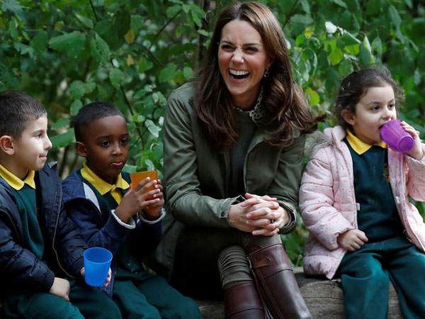 Kate Middleton sitting along few children