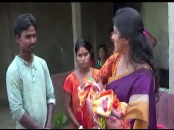 Hailakandi DC Keerthi Jalli (extreme right) with the newborn and the couple. Photo/ANI