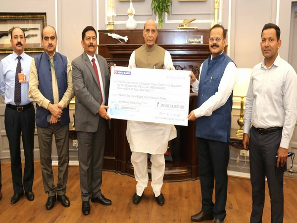 Commodore Siddharth Mishra (Retd), Chairman and Managing Director of BDL giving cheque to Defence Minister Rajnath Singh