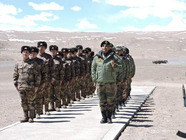Indian and Chinese Army personnel during a Border Personnel Meet organised in Ladakh on Tuesday.