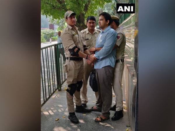 The accused with Delhi police personnel on Tuesday in New Delhi. Photo/ANI