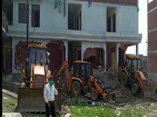Illegal building of Ex-MP Atiq Ahmed's close aide demolished in UP on Sunday. Photo/ANI