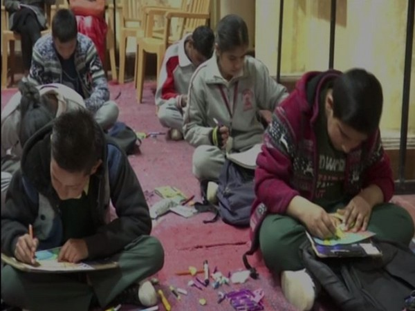 Students take part in a drawing competition in Shimla on Saturday [Photo/ANI]