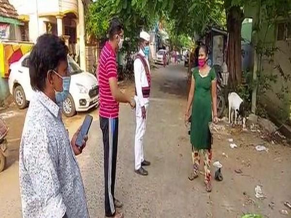 Municipal Commissioner of Kakinada city, Swapnil Dinakar Pundkar, talks to a local resident on Saturday. (Photo/ANI)